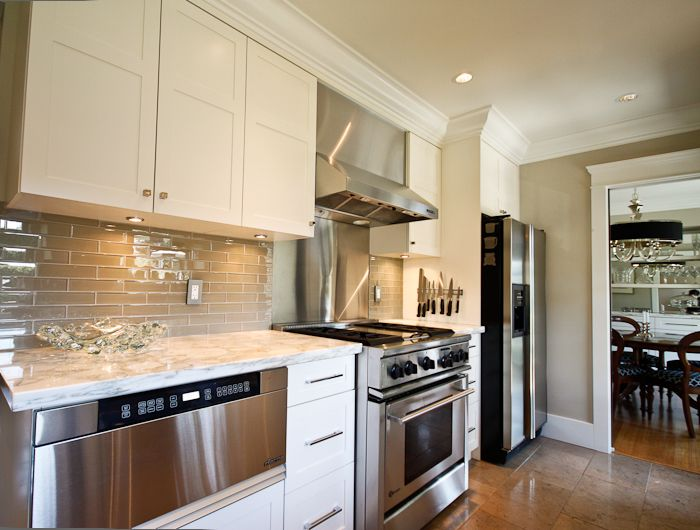 Suzie: Trish Knight - Gorgeous kitchen with creamy white kitchen cabinets, marble countertops, ...