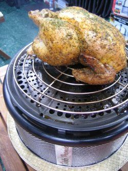 "The ""Million Dollar"" Chicken. The best way to cook a chicken is on the Cobb Grill. Moist, slightly smoked with a beautiful color. Takes 2 and half hours to perfection. Close the lid, forget about it and by the time the heat slows down, it will be done!"