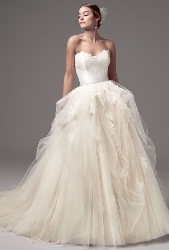 Classic strapless ballgown wedding dress with tulle skirt; Featured Dress: Maggie Sottero