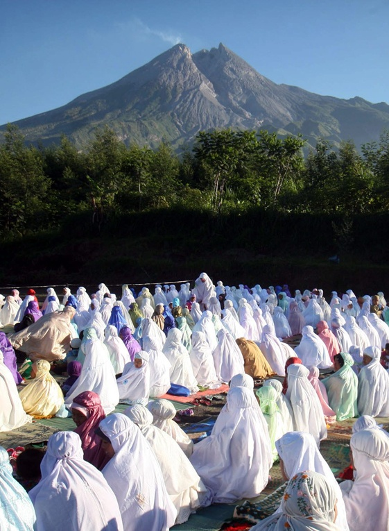 Mountain of Faith. Muslims attending Idul Fitri prayers to mark the end of the Ramadan fasting month against a backdrop of Mount Merapi in Cangkringan, Central Java on Aug. 19. (EPA Photo/Bimo Satrio).