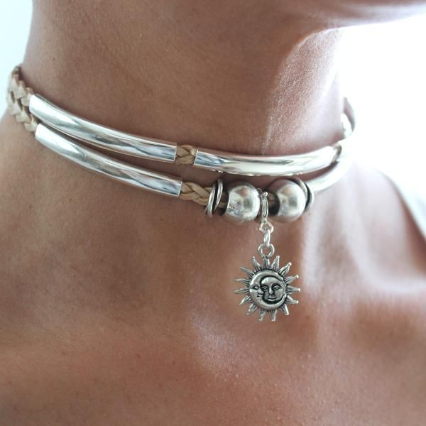 The AngieChoker necklace is a doublestrand braidedleather choker style necklacethat comes adorned witha silver sun moon charm.Handmade in the USA. *We do