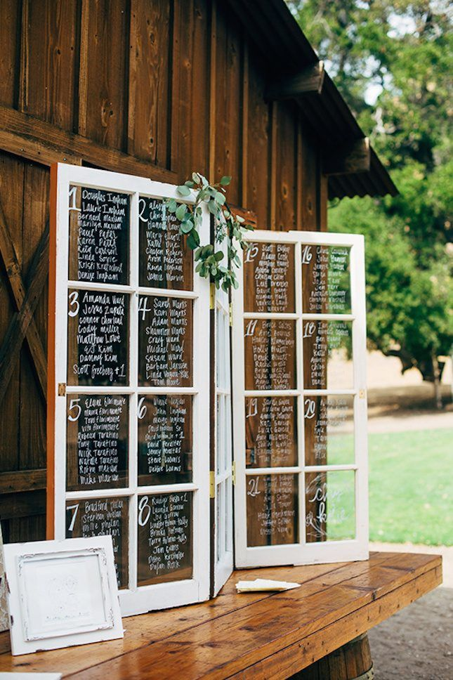 Save these fall wedding ideas for decor inspiration like this seating chart window display.