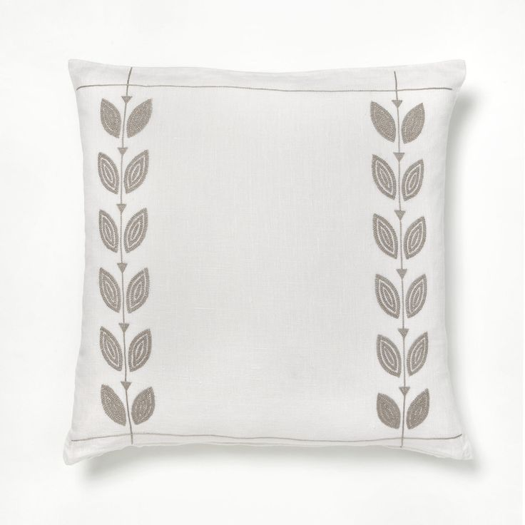 Intricate hand embroidered petals design make this pillow cover a real work of art // more on ARTHA Collections #throwpillows #linenpillows #beigepillows