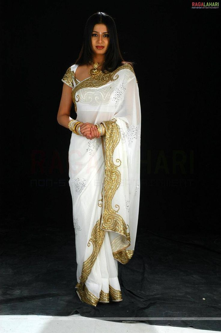 gold weddingndresses | Exquisite, regal, glowing white and gold saree designer saree http://www.shopcost.in/saree