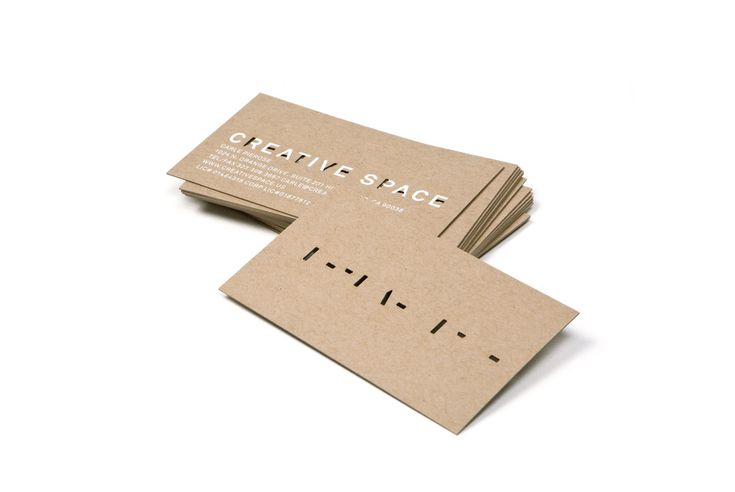 Creative Space uncoated unbleached business card with die cut and white ink detail designed by RoAndCo Studio.
