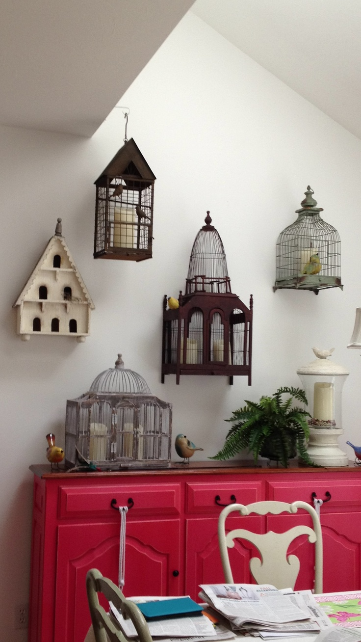 We love this idea! Hung birdcages filled with Luminara flameless candles.