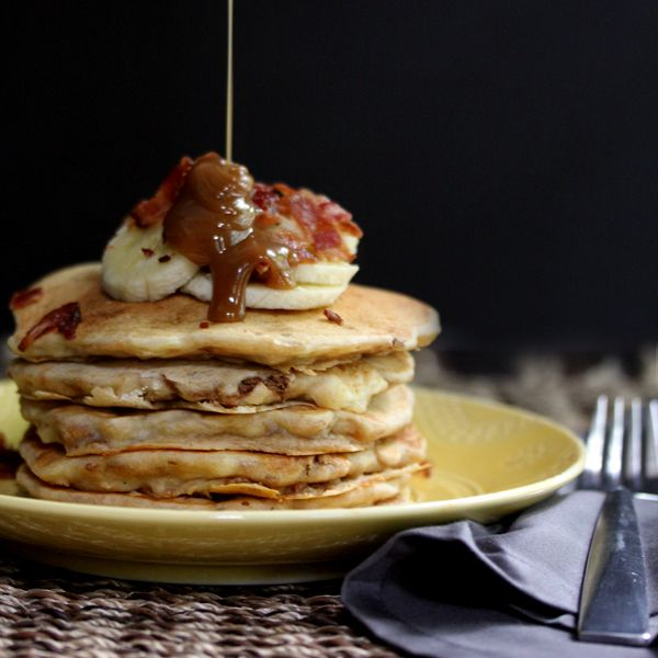 These Peanut Butter Banana Bacon Pancakes taste as good as they sound, especially when topped with Peanut Butter Maple Syrup!  Flapjacks flavored with banana and melted peanut butter and then studded with bacon.  You'll wish it was breakfast all day long!  I've mentioned before that breakfast is a popular meal at our house, especially for...