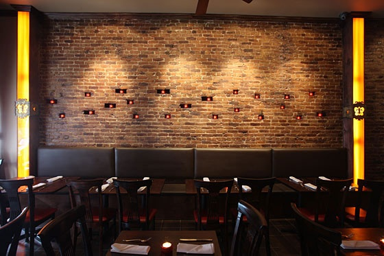 candles set in missing bricks in an exposed brick wall  Interiors  Commercial  Acoustic
