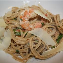 Toss hot, cooked pasta with cream and parsley, spoon the rich shrimp with champagne and cream sauce over the pasta, and top with Parmesan cheese for a meal made for a king. Simple to make, especially if you purchase shrimp that has already been peeled.
