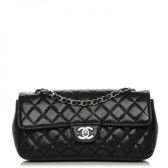 This is an authentic CHANEL Caviar Quilted East West Flap Bag in Black. This chic shoulder bag is crafted of luxuriously textured diamond quilted caviar leather in black.