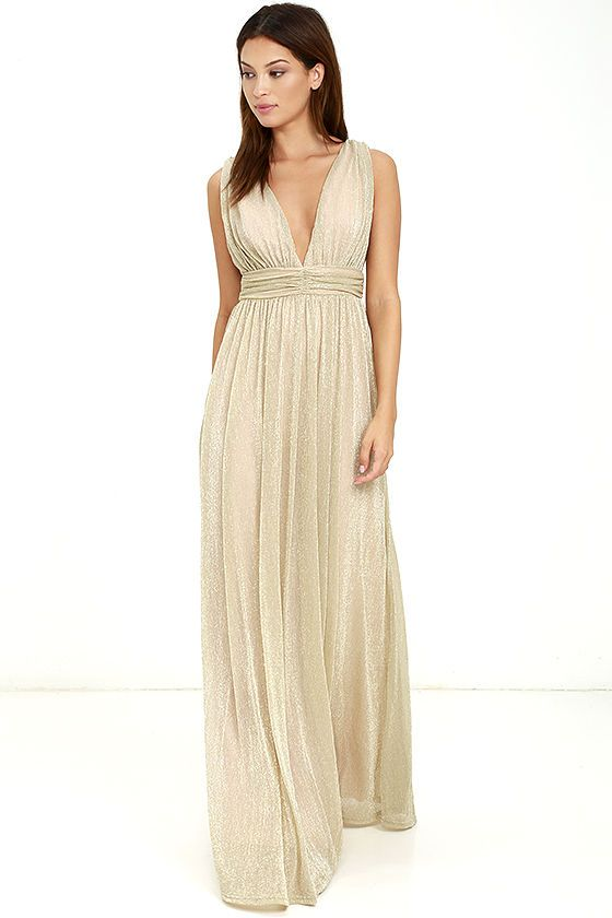 Diamonds are divine, but dresses are better ... so treat yourself to the What a Treat Gold Maxi Dress! Beige knit with metallic gold threading sparkles and shines as it falls from gathered shoulders (with no slip strips), into a sleeveless bodice with a deep V front and back. A banded waist, with ruched detail, introduces a sweeping maxi skirt. Hidden back zipper/clasp.