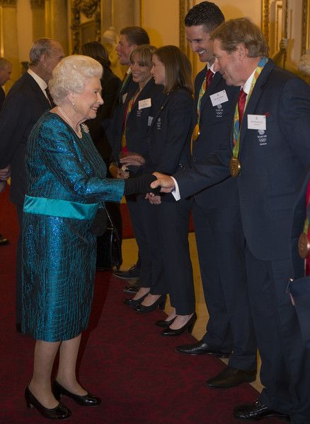 Queen Elizabeth II speaks with Nick Skelton at a reception for Team GB's 2016 Olympic and Paralympic teams at Buckingham Palace October 18, 2016 in London, England.