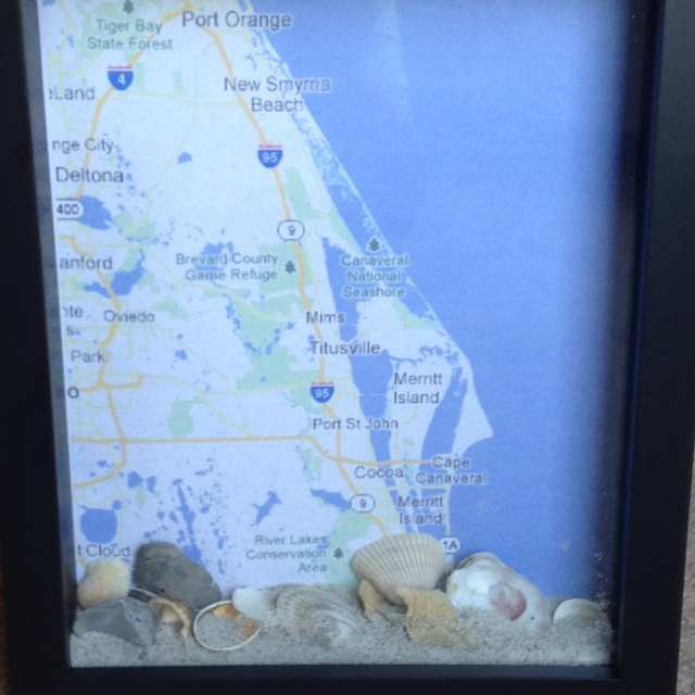 Display shells and sand with a map of where they came from in a shadow box.