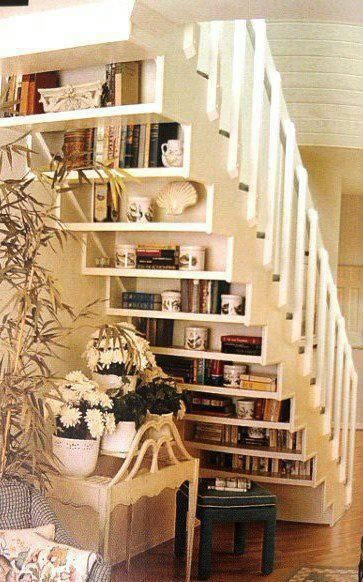 Install shelves on the underside of an open staircase for extra storage and display surfaces