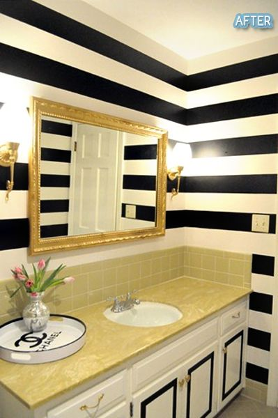 black & white striped walls + gold mirror + chanel tray ♥ I would do a differant vanity cause that doesnt match at all and those tiles look completely out-dated & ghetto . . .
