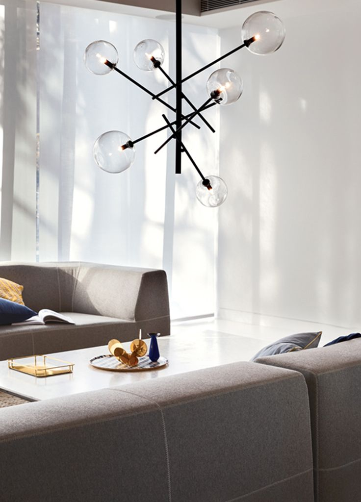 The Beacon Lighting Aksel 6 light pendant in black with clear glass.
