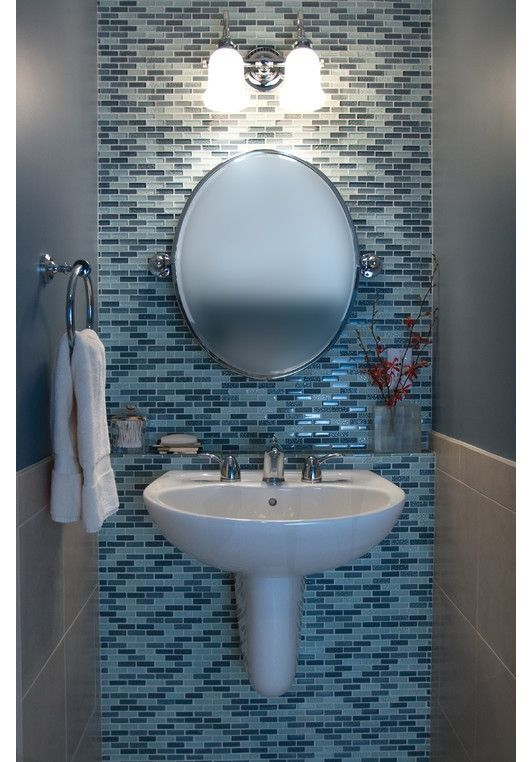 Wall mounted sinks help save space in a small bathroom for Powder blue bathroom ideas