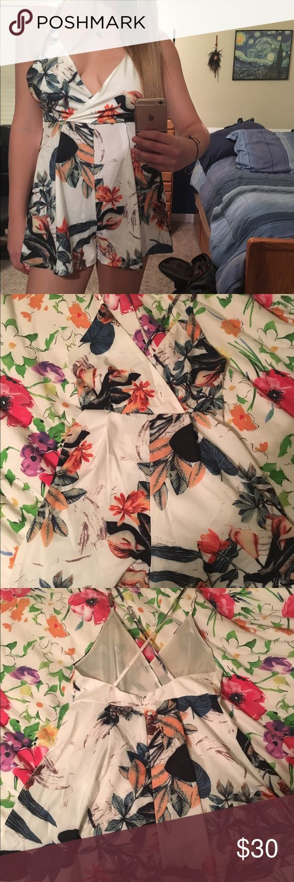 Print Romper NWOT never been worn Hawaiian/floral print romper. Size medium! Got it off an Australian website but it's a little small for me- fits true to size. Super cute and perfect for summer! Criss cross back with adjustable straps :) ROMWE Pants Jumpsuits & Rompers