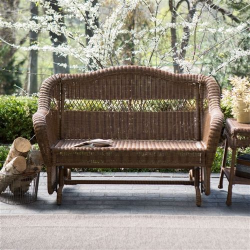 Full of Southern charm, this Walnut Resin Wicker 2-Seat Outdoor Glider Bench Patio Arm-Chair is as pretty as a magnolia in full bloom and glides as smooth as sweet tea. Its generous scale makes it the perfect spot for two or more