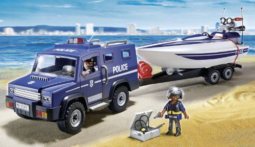 PLAYMOBIL Police Truck with Speedboat  PLAYMOBIL Police Truck with Speedboat Protect by land and sea with the Police Truck with Speedboat. Race to the scene in the police truck, equipped with a removable roof and four working doors that make it easy to seat up to four figures. Kids can also embark on a water investigation with the floating speedboat. Cruise through the water automatically with the included underwater motor, and when the day's work is over, use the trailer winch to pu..
