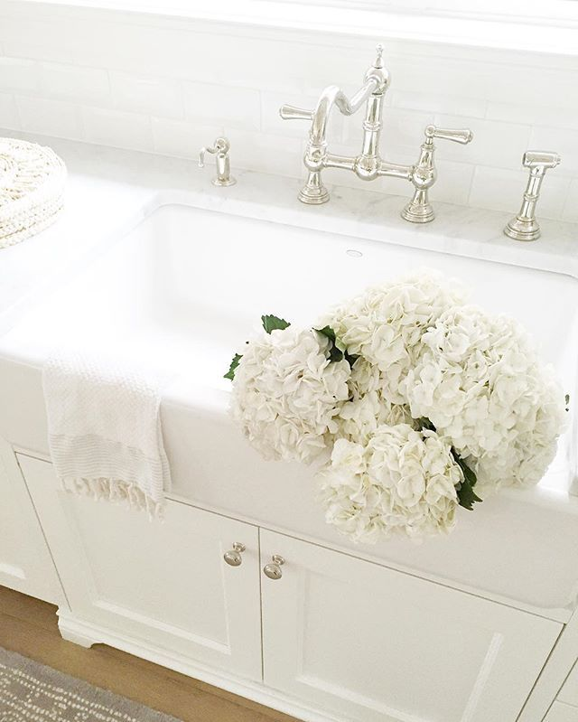 Farmhouse sink  White kitchen  Rohl faucet  Marble counters