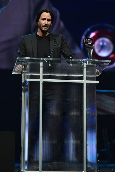 Keanu Reeves Photos Photos - Actor Keanu Reeves accepts the Vanguard Award during the CinemaCon Big Screen Achievement Awards brought to you by the Coca-Cola Company at The Colosseum at Caesars Palace during CinemaCon, the official convention of the National Association of Theatre Owners, on April 14, 2016 in Las Vegas, Nevada. - CinemaCon 2016 - The CinemaCon Big Screen Achievement Awards Brought To You By The Coca-Cola Company - Show