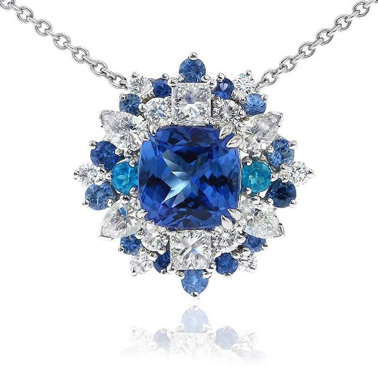 This spectacular Cirque pendant features a square cushion shaped tanzanite at its centre which is accented by blue sapphires, bright blue apatite and sparkling round, marquise cut and princess cut diamonds. By Gerard McCabe.