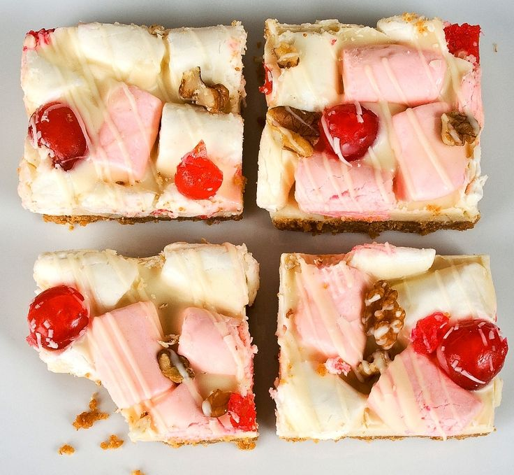 Heavenly. BIG marshmallows, cherries, walnuts and white chocolate on a blonde biscuit base. 15 Squares per tray.
