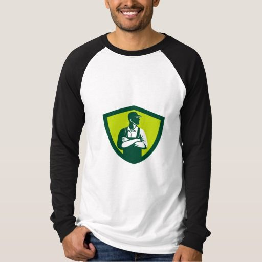 Organic Farmer Arms Folded Looking Side Crest Retr Shirt. Illustration of an organic farmer wearing hat and overalls arms folded looking to the side viewed from front set inside shield crest on isolated background done in retro style. #Illustration #OrganicFarmerArmsFoldedLooking