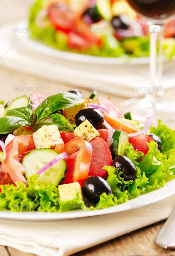 Greek salad on the oak table
