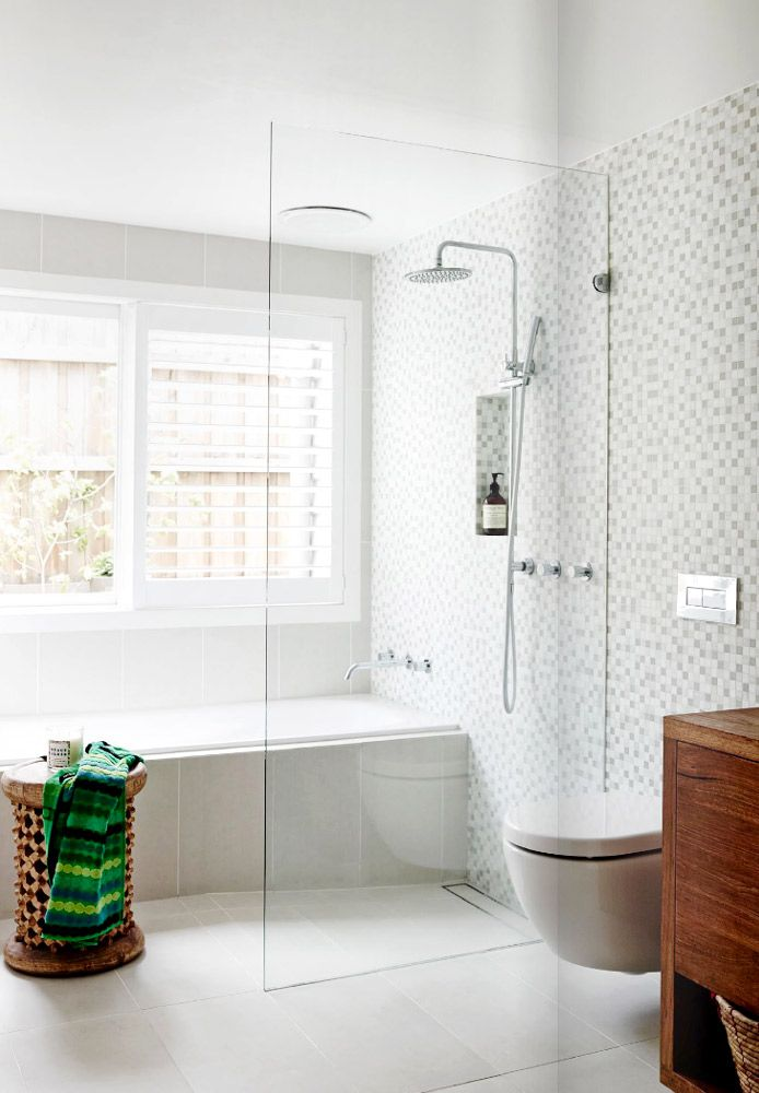 White tile bathroom with glass shower