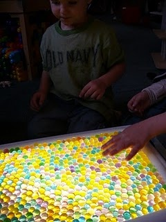 Water beads over a light table