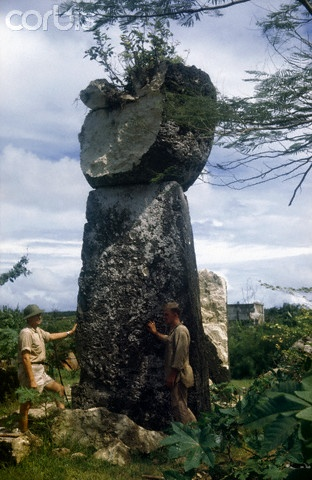 Men stand beside pillars left by a forgotten Chamorro civilization - 42-24145824 - Rights Managed - Stock Photo - Corbis. Tinian Island, Northern Mariana Islands. 1945.