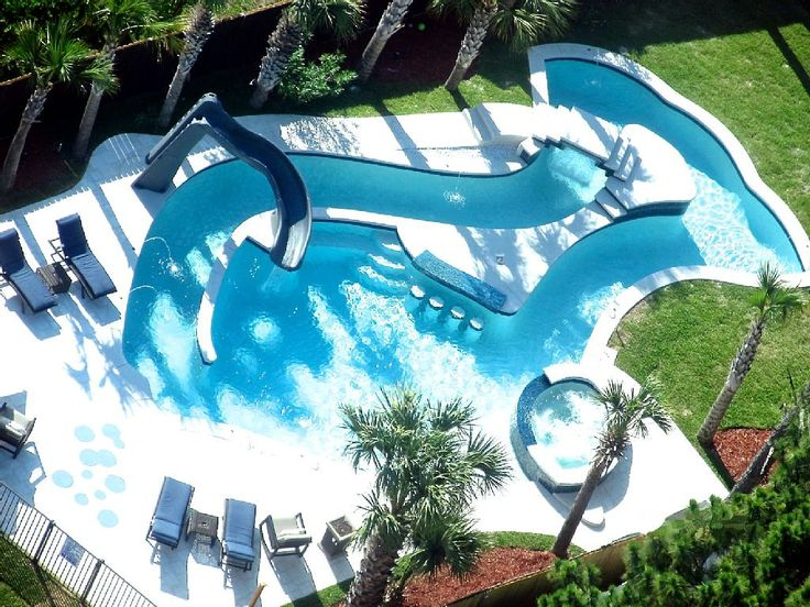 This pool has it ALL. Lazy river, slide, swim-up bar, jacuzzi, fountains...can you believe it?
