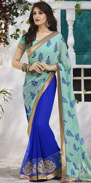 Alluring Green And Navy Blue Georgette Saree With Blouse.
