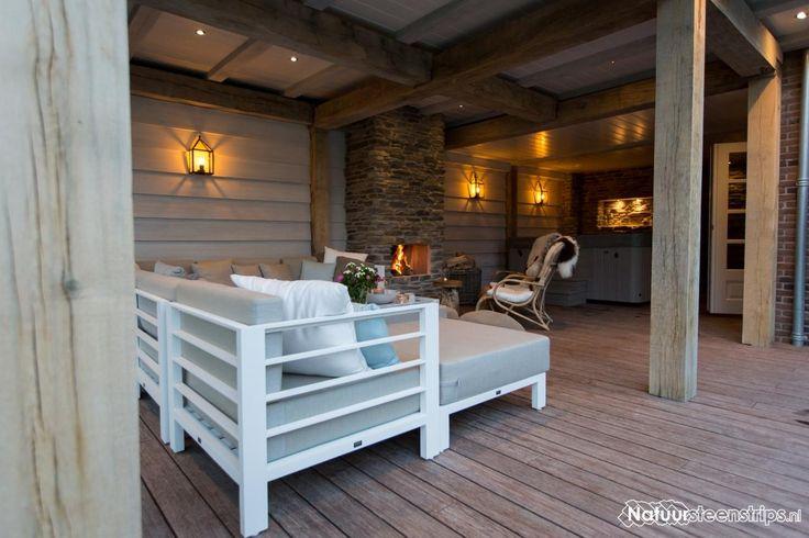 Zeer gezellige veranda. Haard voorzien van CottageStones.