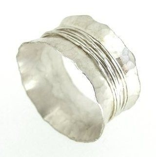 Handcrafted silver ring which has been slightly hammered.  The central point has been wrapped with wire for added detail.  A chunky thickset ring which is suprisingly light to wear.  Comfortable to wear and contemporary design.  Size S  Width 13mm