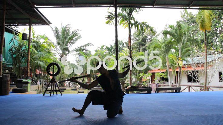 Sword Fighting Silhouette Demonstration Weapon Blade Martial Arts - Stock Footage   by RyanJonesFilms #muaythai #athlete #fitness #fight #boxing #training #padwork #mma #motivation #sport #gym #combat #video #silhouette #swords #swordfighting #demonstration #krabikrabong