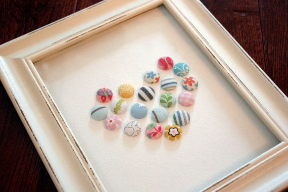 BABY / buttons made out of their baby clothes and made into art.