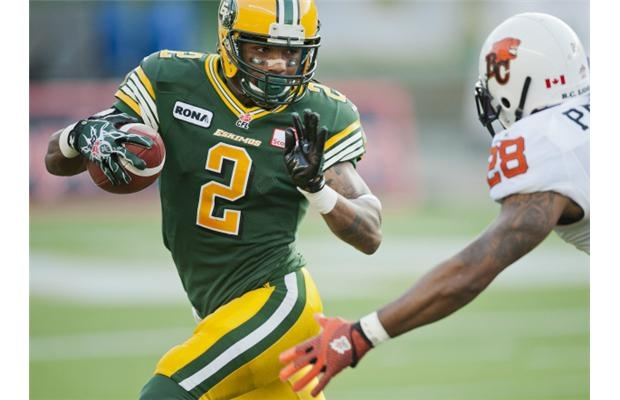 Edmonton Eskimos Fred Stamps, 2, doges BC Lions Byron Parker, during the first quarter of the CFL football game in Edmonton, Alta., on Saturday, September 22, 2012  Photograph by: John Ulan , THE CANADIAN PRESS
