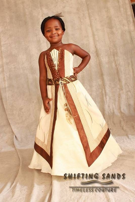 Lythwood Weddings loves this traditional African flower girl dress by Shifting Sands. Children's garments are playfully designed to add the final touches to the wedding party! <3  lythwoodweddings.co.za #lythwood #weddings #flowergirl