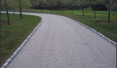 Tar and Chip Driveway - A contractor will first apply a hot mix liquid asphalt cement to a gravel base or your existing driveway (provided that it is in good condition). Next, one or two layers of the crushed stone (of your choice) will be spread on top of the hot asphalt and compacted down. The end result is a stunning and unique driveway that is customized to your specific desires. Benefits: Lower Overall Cost, Natural Beauty, Low Maintenance, Traction, and Longevity.