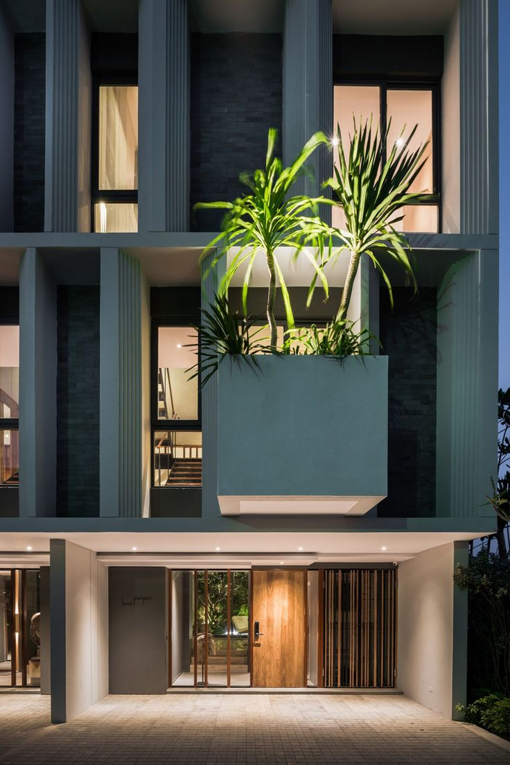 The facade of these townhouses welcomes visitors with cantilevered planter boxes