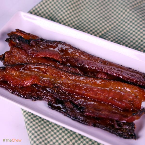 Sticky Sweet Bacon by Daphne Oz!  6 tablespoons Maple Syrup 6 tablespoons Brown Sugar 2 teaspoons Dijon Mustard 1/2 teaspoon Freshly Cracked Black Pepper 1 pound Thick Cut Bacon (about 12 slices) Bake on wire rack 300 degrees for 45-60 min.