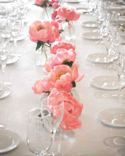 Short glass vases were filled with flamingo pink peonies. Wedding table centerpiece settings #decor