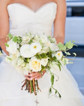 An all-white bouquet of roses, Japanese anemones, and ranunculus