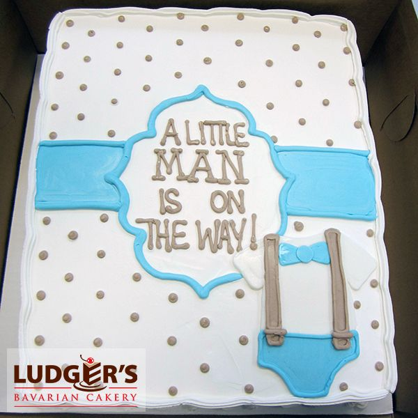 Baby shower cake for a boy with cute blue bow tie and suspenders on a onesie!