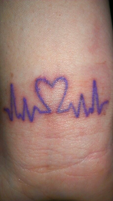My FIRST ever tattoo!! In honor of my daughter and the other Epilepsy warriors!!  Purple brain waves and heart! Had it placed on my wrist :-)