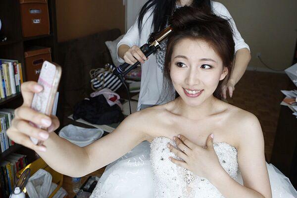 Asian wedding, taking selfie during preparation  by Sherry Hu