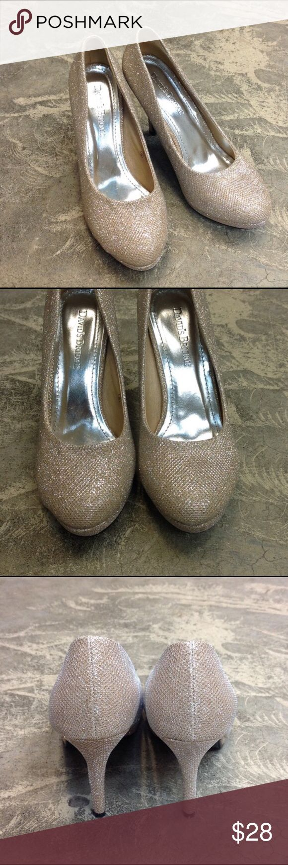 Gold sparkle pumps Davids Bridal Bought these from another posher that only wore them once. Wanted them for my friends wedding but she changed her mind on the shoe color so I'm selling them.  I haven't worn them at all.  They would be perfect for a wedding. David's Bridal Shoes Heels